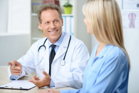 Professional doctor examining his patient
